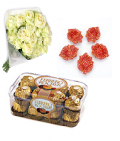 Luxury white roses with sweet Ferrero Rocher 16 pc and Designed Earthen Diyas Gifts toAmbad, Combinations to Ambad same day delivery