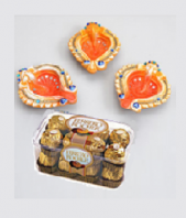 Orange Diyas and Ferrero Rocher 16 pc Gifts toAmbad, Combinations to Ambad same day delivery