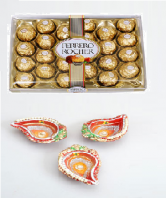 Ferrero Rocher 24 pc and Kalka Shaped Earthen Diya Set Gifts toOjhar, Combinations to Ojhar same day delivery